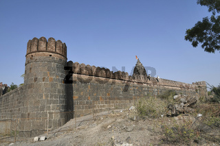 Stone masonry wall with Cylindrical watch towers at intervals surrounding entire village of  Vitthal Temple, Palashi, Parner, Ahmednagar