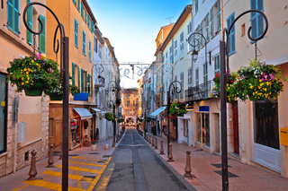 Colorful street in Antibes walkway and shops view