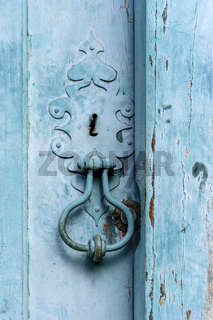 Old blue wooden house door and knob