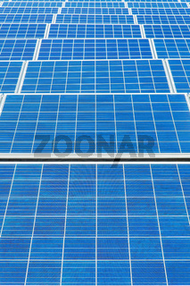 Symmetrical blue field with many  solar panels