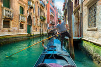 Gondolier with a paddle