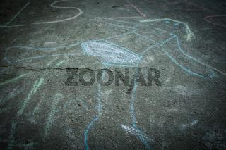 children drawing art with chalk on asphalt