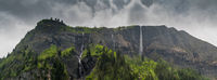 panorama mountain landscape with lush green forest and several waterfalls