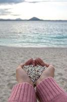 Holding on white pebbles