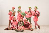Stylish girls in bright costumes of pink pigs