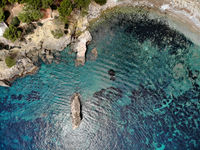 Cala en Cranc rocky seaside in the Palma de Majorca directly from above drone point of view photo, picturesque nature stony beach turquoise Mediterranean waters from top image, Balearic Islands Spain