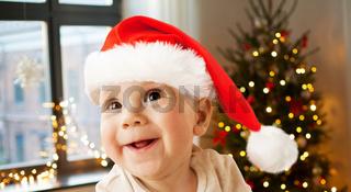happy little baby boy in santa hat on christmas