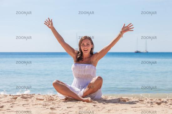 Happy woman on sea beach