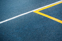 Asphalt surface with white and yellow lines