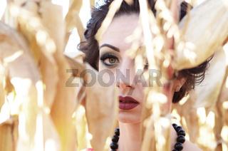 Young caucasian brunette woman portrait at cornfield