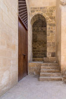 Stone staircase leading to vaulted entrance at stone bricks wall
