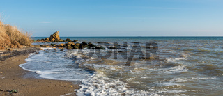 Sunny autumn day on the seashore
