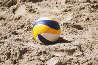beach volleyball ball in the sand
