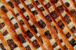 homemade apple pie with a lattice pastry crust covered with cinnamon and granulated sugar