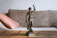 lady justice or justitia statue on table - landlord and tenant law