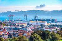 Lisbon skyline, cranes and cargo containers
