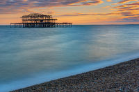 The remains of the Brighton West Pier seen at sunset
