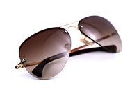 Brown aviator sunglasses on white