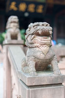 Lion stone statues in a buddhist temple