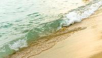 Seaside beach and soft blue sea wave.