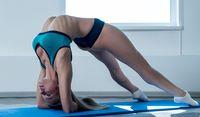 Flexible girl posing during workout in gym