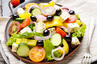 Mediterranean diet dish greek salad on vintage metal tray closeup photo