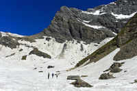 Hikers walking across the Plan Salentse cirque on the way to the Rambert Hut, Ovronnaz,Switzerland
