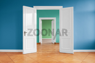 open doors in empty apartment with colored walls -