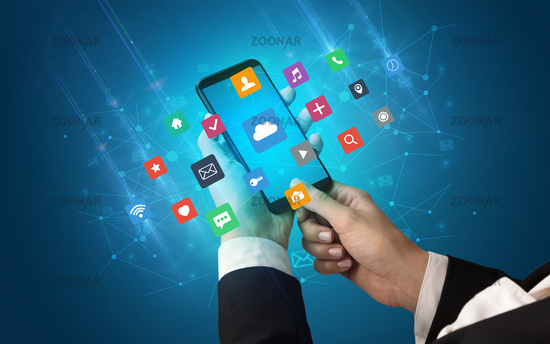 Hand using smartphone with application icons