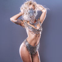 Hallooween sensual, beautiful blonde woman with intense look wearing a silver mask with skull and metal pieces, halloween