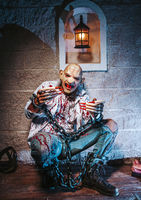 halloween costume, Man chained with blood and knife, Zombie man death the ghost horror drain hand blood skin is screaming darkness and nightmare background of scary fear on hell is monster devil  in halloween festival concept