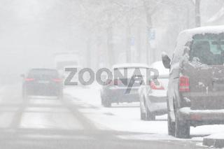 Driving car in heavy snowfall