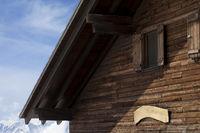 Top floor of wooden hotel in winter mountains