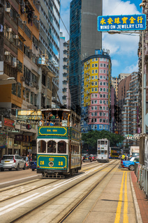 HONG KONG - April, 29, 2018: Double-decker tram in Wan Chai district of Hong Kong.