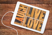 laugh, live, love word abstract in wood type