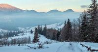 Sunrise winter Carpathian mountain village, Ukraine