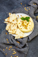 Homemade traditional hummus with pine nuts.