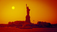 the Liberty Statue at sunset