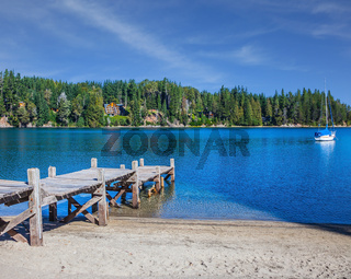 Wooden boat pier on the lake