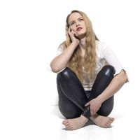 Young thoughtful woman cross-legged