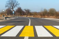 pedestrian crossing outside the city, white yellow markings on the road