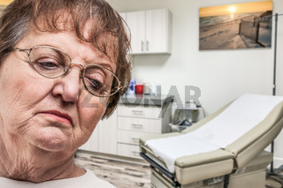 Worried Senior Adult Woman Waiting in Doctor Office