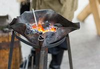fire blacksmith forge handmade burnt metal with winding wavy edges