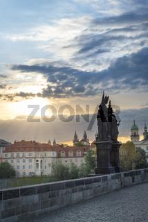 Sunrise over Prague and Charles Bridge