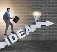 Concept of idea with businessman climbing steps stairs