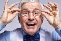 Close up portrait of funny smiling cheerful senior businessman clerk with glasses