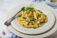 Italian pasta with green peas and blue cheese.