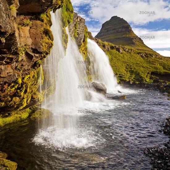 Kirkjufellsfoss Waterfall and Mount Kirkjufell, near Grundarfjördur, Snæfellsnes, Iceland