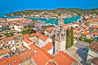 Town of Vela Luka on Korcula island church tower and coastline aerial view