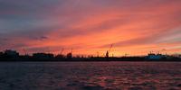 Elbe River in Hamburg Harbor at sunset.